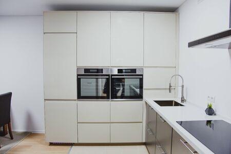 minimalistic kitchen interior, sink, oven, stove range hood close up
