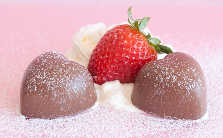 Decadent Chocolate hearts with strawberries and cream photo