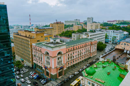 Summer, 2015 - Vladivostok, Russia - A historic pink building in the center of Vladivostok. View from above. The central street of Vladivostok.