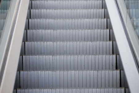 Close-up. Infrastructure at the airport. Metal escalator steps