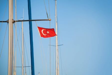 mast: Ship mast with the Turkish flag over blue sky background