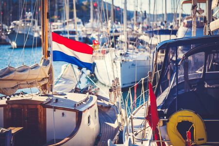 rigger: Netherlands flag on mast of a yacht standing in marina Stock Photo