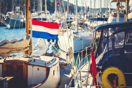 rigger: Flag of Netherlands against the background of sailing ship.