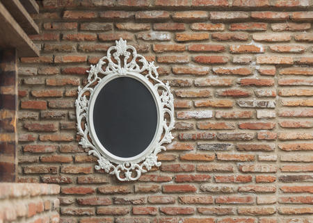 mirror frame: The mirror in a white frame on old brick wall Stock Photo