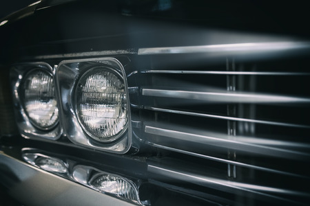 front of: Color detail on the headlight of a vintage car. Stock Photo