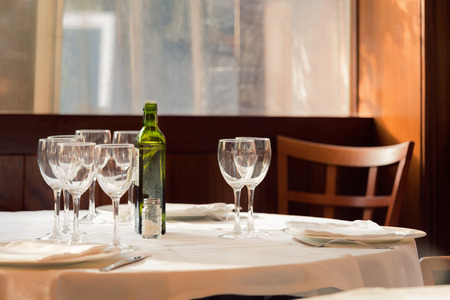 The restaurant serves for lunch. Photos with beautiful bokeh and wooden chairs