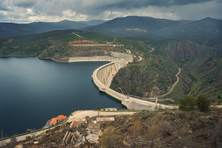 birdeye: River And Massive Dam Surrounded By Mountains Wide Angle Bird-eye View Photo Stock Photo