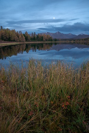 orientated: Mirror Surface Lake Autumn Vertically Orientated Landscape With Mountain Range On Background