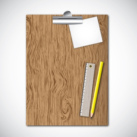 Paper pad on wooden clipboard with tools , pencil and ruler  photo