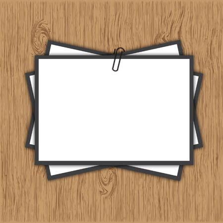 Paper clip with note pad on wooden background