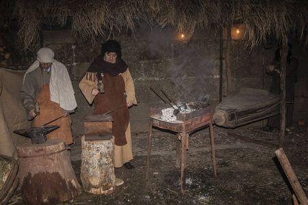 Living Bethlehem Christmas 2012, Navamorcuende, Toledo, Spain, forge, blacksmithing, blacksmith, Stock Photo - 17063188