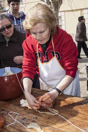Women by making garlic sausages, 2  February  2013 Aldeanueva de Barbarroya, Toledo