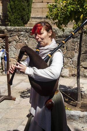 fiestas: street musicians with bagpipes, Medieval Market, Oropesa, Toledo, Spain, 21 04 2013
