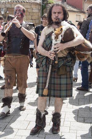 fiestas: Scottish Piper, Medieval Market, Oropesa, Toledo, Spain, 21 04 2013 Editorial