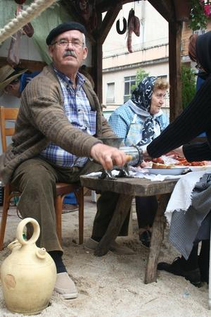 isidro: man working in the field, Festivals of San Isidro, Talavera May 15, 2013