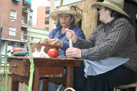 isidro: woman cooking, Festivals of San Isidro, Talavera May 15, 2013