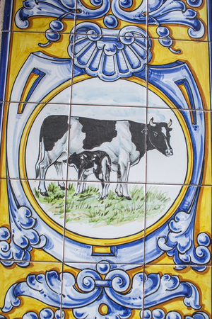 Ceramics of Talavera de la Reina, rosette of a cow are her calf
