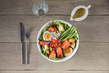 vegetable salad top view with salmon and boiled egg salad on wooden background Standard-Bild