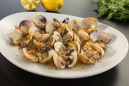 grilled clams on a plate, on a table