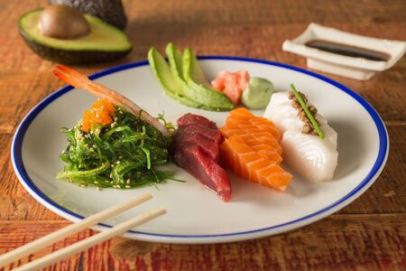 salmon, tuna and butter fish in pieces for sushi on a plate