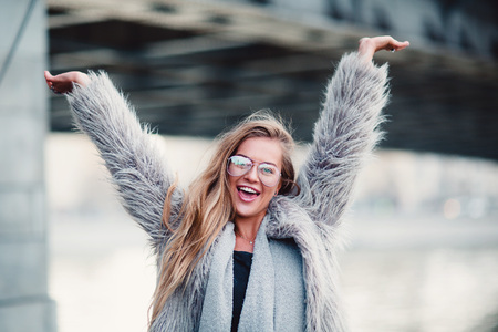 Close up shot stylish happy young woman with hands up Stok Fotoğraf