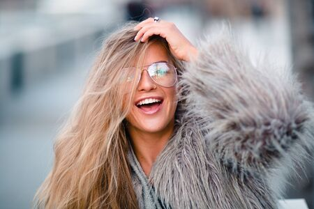 Close up shot stylish happy young woman in coat