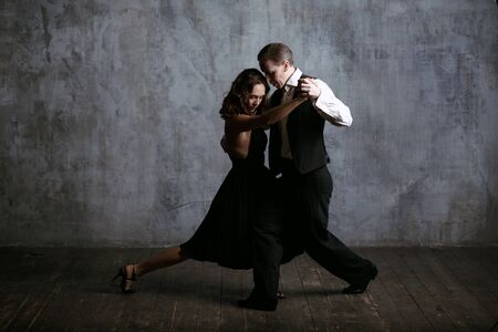 Young pretty woman in black dress and man dance tango Stok Fotoğraf - 99340296