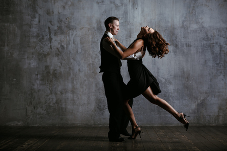 Young pretty woman in black dress and man dance tango Stok Fotoğraf - 99150024