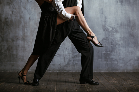 Young pretty woman in black dress and man dance tango Stok Fotoğraf - 99340300