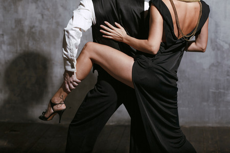 Young pretty woman in black dress and man dance tango Stok Fotoğraf