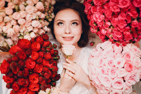 Dreaming young female and flowers. Aromatherapy Stok Fotoğraf