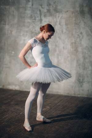 Ballerina female. Young beautiful woman ballet dancer, dressed in professional outfit, pointe shoes and white tutu. Stok Fotoğraf