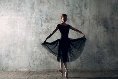 Ballerina in transparent black dress. Young beautiful woman ballet dancer, Stok Fotoğraf