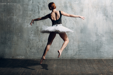 Ballerina female. Young beautiful woman ballet dancer, dressed in professional outfit, pointe shoes, black top and white tutu. Stok Fotoğraf