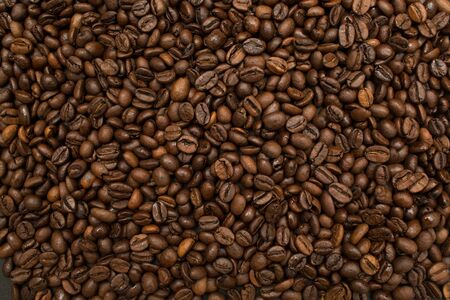 Roasted coffee beans brown seeds texture background wallpaper. Top view. Stok Fotoğraf