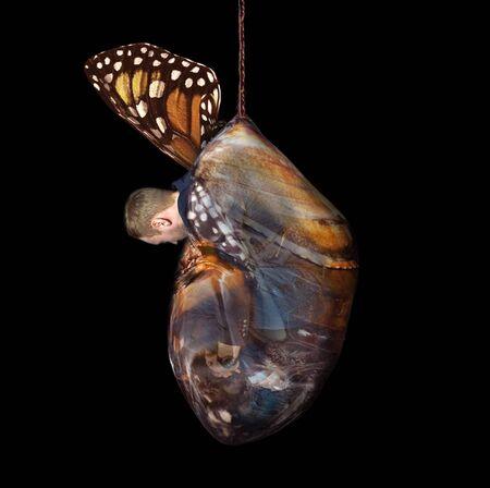 Beginner businessman man in cocoon, butterfly pupa. Startup and venture investment concept.