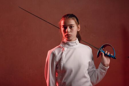 Fencer woman with fencing sword. Stock Photo