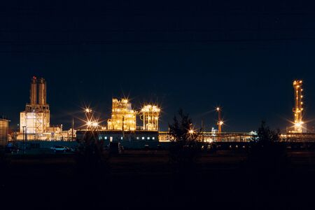 Petrochemical Factory Plant with lights at night.