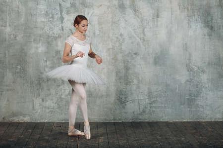 Modern ballet, great design for any purposes. Ballet dancer ballerina. Balance training. Classical choreography style. Beautiful dancer ballerina. Classical music. Elegant ballet style.