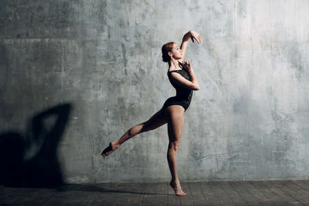 Modern ballet, great design for any purposes. Ballet dancer ballerina. Balance training. Classical choreography style. Beautiful dancer ballerina. Classical music. Elegant ballet style. Banque d'images - 151112124