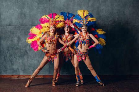 Three Woman in brazilian samba carnival costume with colorful feathers plumage Stock fotó