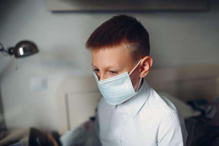 Little boy dressing uniform and medical mask preparation back to school. Stok Fotoğraf - 154528970