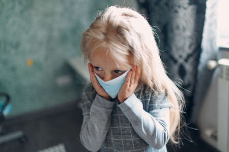 Little girl dressing uniform and putting face mask preparation back to school