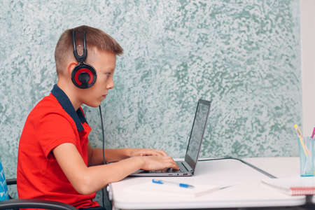 Young student boy with laptop learning and preparing back to school Stok Fotoğraf - 154753850