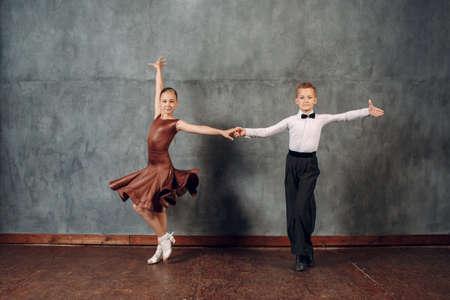 Young dancer boy and girl dancing in ballroom dance Samba