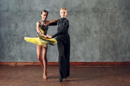 Young man and woman dancers dancing in ballroom dance cha-cha-cha. Stok Fotoğraf - 154753866
