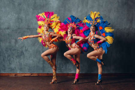 Three Women in cabaret costume with colorful feathers plumage Stok Fotoğraf - 154753868
