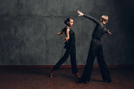 Young couple dancing in ballroom dance Paso doble Stok Fotoğraf - 154782542