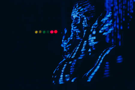 Young man with blue letters on his face in the dark. Stok Fotoğraf