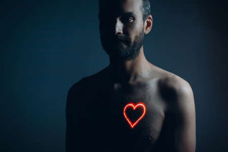 Adult man torso with heart shape on the chest. Healthy human heart. Stok Fotoğraf